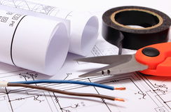 Accessories for engineer jobs and rolls of diagrams on construction drawing Stock Images