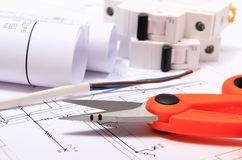 Accessories for engineer jobs and rolls of diagrams on construction drawing Royalty Free Stock Photos