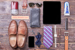 Accessories and Father`s Day card. Gadgets, wallet and shoes. Complete dad`s look by accessories Royalty Free Stock Photography