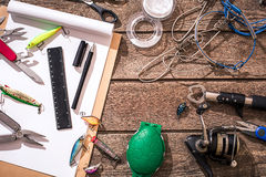 Accessories for fishing on the background of wood. Top view Royalty Free Stock Images