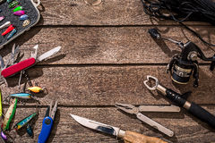 Accessories for fishing on the background of wood. Top view Royalty Free Stock Photos