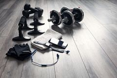 Accessories and fitness equipment for fitness. Training kit with phone and headphones stock images