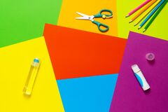 Free Accessories For Children Creativity And Leisure. Glue, Scissors And Pencils For Application On Colored Paper Background Stock Image - 216145601