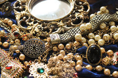 Accessories. Gold accessories at blue background Royalty Free Stock Image