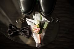 Accessories groom on a glass table. sunlight stock images