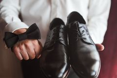 Men accessories. Accessories for the groom shoes, butterfly Royalty Free Stock Photography