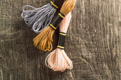 Accessories for hobbies: different colors of thread for embroide Stock Photos