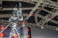 Accessories for 4k TV camera in a concert hall with laser lighting. Professional digital video camera. stock photography