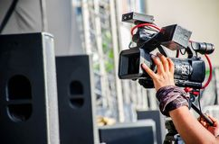 Accessories for 4k TV camera in a concert hall with laser lighting. royalty free stock photo