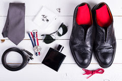 Accessories. Man's style, urban shoes, socks and accessories on wooden table Royalty Free Stock Photo