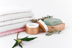 Accessories for massage. Soft coton towels, pomade and olive soap on the white background royalty free stock images