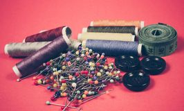 Supplies and accessories for sewing - threads, pins, buttons, centimeter. royalty free stock images