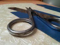 Accessories for office. Measures for handicrafts: scissors,  rule and beautiful sheets of cartons Stock Photography