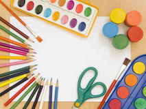 Accessories for painting. Paintings, brushes, pencils and other school accessories Stock Photography