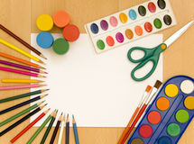 Accessories for painting. Paintings, brushes, pencils and other school accessories Stock Images