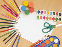 Accessories for painting. Paintings, brushes, pencils and other school accessories Royalty Free Stock Photo