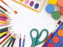 Accessories for painting. Paintings, brushes, pencils and other school accessories Stock Photo