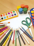 Accessories for painting. Paintings, brushes, pencils and other school accessories Royalty Free Stock Photos