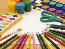 Accessories for painting. Paintings, brushes, pencils and other school accessories Royalty Free Stock Image