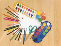 Accessories for painting. Paintings, brushes, pencils and other school accessories Stock Image