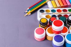 Accessories for painting. Paints, Brush and Colored Pencils stock photo
