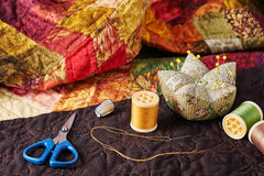 Accessories for patchwork on a quilt Royalty Free Stock Image