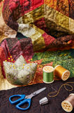 Accessories for patchwork on a quilt Royalty Free Stock Images
