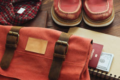 Accessories prepared for travel. Accessories and other belongings necessary in the day off trip - sturdy boots, warm flannel shirt, sketchbook, passport and some royalty free stock image