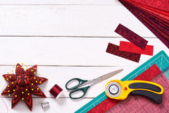 Accessories for quilting on a white wooden surface, top view Royalty Free Stock Photography