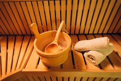 Accessories for sauna. Closeup of sauna accessories like towels ,wooden ladle and spoon Royalty Free Stock Images