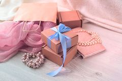 Accessories set for women, wooden light background. royalty free stock photos