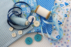 Accessories for sewing in blue-white c. Accessories for sewing: threads, fabric, buttons in blue-white color Royalty Free Stock Photos