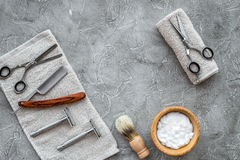 Accessories for shaving. Shaving brush, razor, foam, sciccors on grey stone table background top view copyspace Stock Images