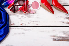 Accessories and shoes on wood. Stock Photo