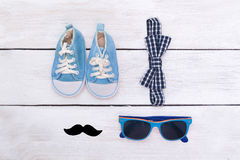 Accessories for a small gentleman. Bow tie and mustache. flat la. Accessories for a small gentleman. Bow tie and mustache Royalty Free Stock Photo