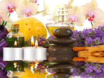 Accessories for spa with orchids, lavender, stones, candles and Royalty Free Stock Photography