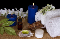 Accessories for spa treatments in the candlelight Stock Photos