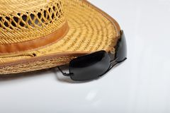 Accessories for summer holidays. Straw hat and sunglasses. On a white background.  royalty free stock photography