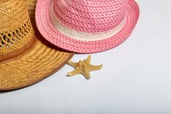 Accessories for summer holidays. Sun hats and starfish on a white background.  royalty free stock photos