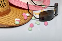 Accessories for summer holidays. Sun hats, sunglasses, colored pebbles and starfish on a white background.  stock photos
