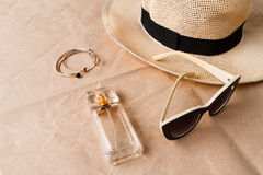 Accessories sunglasses perfume and hat over craft background. Stock Photo