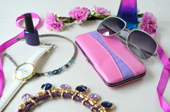 Accessories - sunglasses, wrist watches. Rims Royalty Free Stock Photos