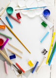 Accessories to drawing: paper, paints, brushes, pencils. Top view. Stock Photo