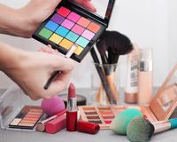 Accessories to a make-up on a gray table royalty free stock photo