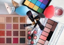 Accessories to a make-up on a gray table. Top view royalty free stock photography