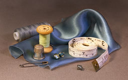 Accessories to sewing. And a silk rag Royalty Free Stock Photography