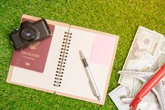 Accessories for travel. passport,camera,us dollar banknote. Top view, flat. Holiday, tourism and travel concept background royalty free stock image