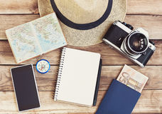 Accessories for travel. Passport, photo camera, smart phone and travel map. Top view. Holidays and tourism concept. Top view of different accessories for travel Royalty Free Stock Images