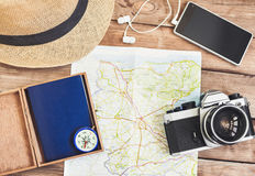 Accessories for travel. Passport, photo camera, smart phone and travel map. Top view. Holidays and tourism concept. Top view of different accessories for travel Stock Photography