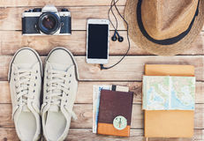 Accessories for travel. Passport, photo camera, smart phone and travel map. Top view. Holidays and tourism concept. Top view of accessories for travel: passport Royalty Free Stock Image
